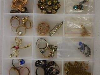 Assortment of jewelry   rings  brooches  bracelets