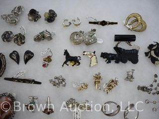 Assortment of jewelry  mostly earings  brooches