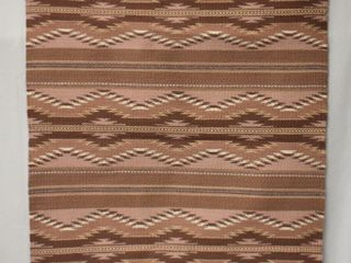 Southwest Native American style rug wall hanging in soft earth tones