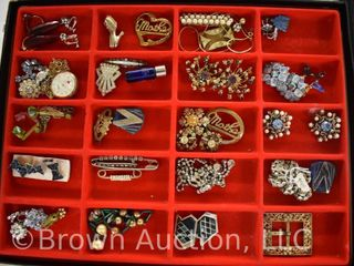 Assortment of jewelry  necklaces  earrings  brooches  belt buckle
