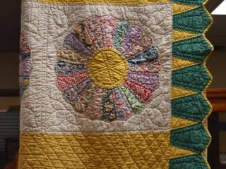 Multi colored in yellow and green quilt