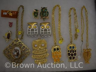 Assortment of jewelry  necklaces   brooches