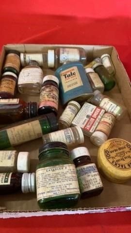 BOX OF ANTIQUE MEDICINE JARS AND TAlC TIN