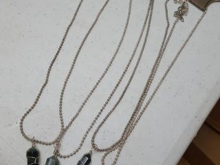 4 Necklaces with stone pendants
