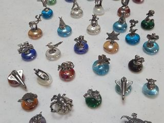 Approximately 30 miniature figurines on polished glass nuggets
