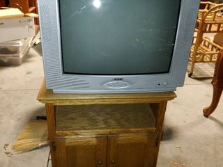 large Apex Television   Short TV Table with Cabinets   TV Turns On    Table   26  T x 25  W x 35  l