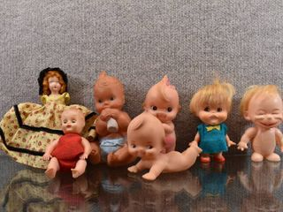 Vintage lot of 7 Doll Collection Kewpie Type and others  Various Makers