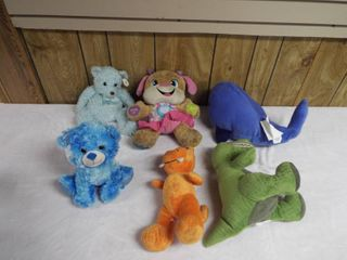 lot of various stuffed animal s in a crate