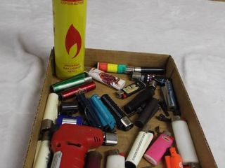 lot of various lighter s and a can of lighter butane