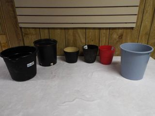 lot with a bucket and small flower pot s
