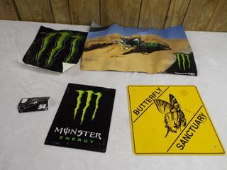 lot with monster stickers and sign s and a butterfly sign