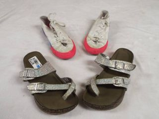 1  pair of girl s converse size 2 and a pair of girl s sandle s size 4