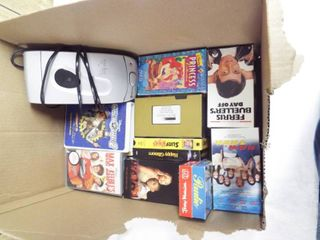 lot with VHS rewinder and VHS movie s