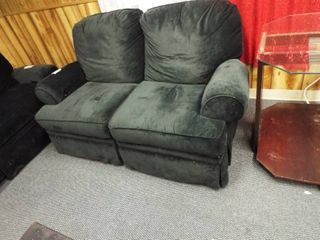Green Reclining love seat  66 5  W  32  D  35 5  T
