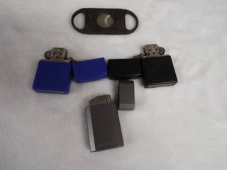 lot with 3 zippo lighter s and a cigar cutter