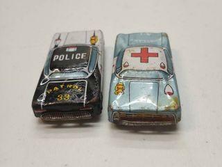 2 old tin type cars 1 cop car 1 ambulance