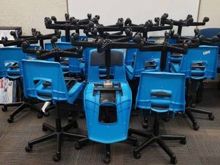 lot of Approx  26 Plastic Blue Rolling Chairs