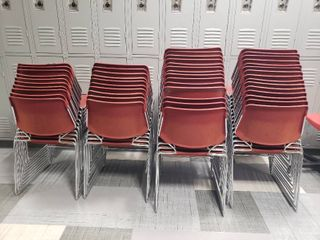 lot of Approx  50 Red Plastic Chairs