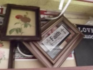 lot of pictures and frames