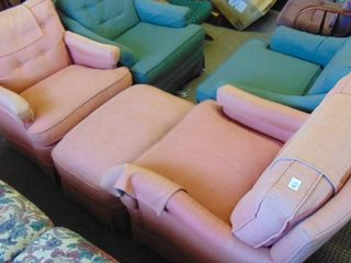 2 pink chairs and ottoman