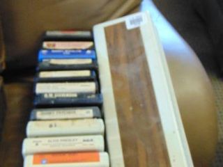 lot of 8 track tapes in holder