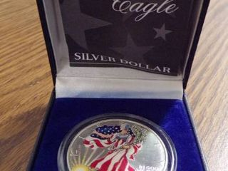 1999 AMERICAN EAGlE PAINTED SIlVER DOllAR