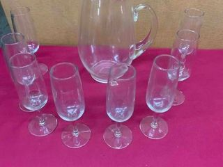 Glass drinking flutes and beverage pitcher