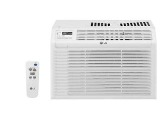 lG Electronics 6 000 BTU 115V lW6017 Window Air Conditioner with Remote Control  Plugged in and powered on