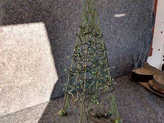 lighted wrought iron Christmas tree