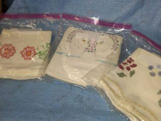 three sets of hand embroidered pillowcases
