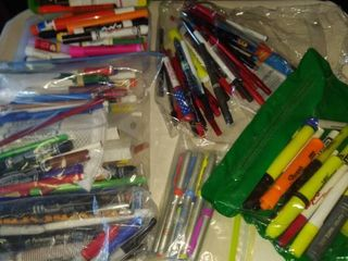 large assortment of highlighters pins pencils glue sticks markers dry erasers etc