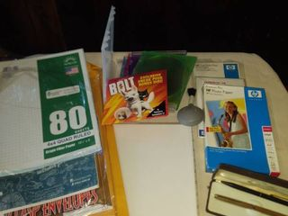 various office supplies a journal DVD holders and a Hallmark