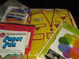 variety of crafting supplies paint smock for child