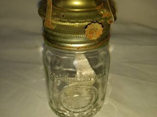 mason jar made into oil lamp