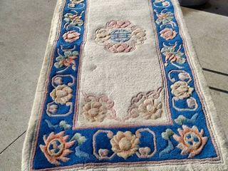 58 x 24 Chinese rug needs cleaned