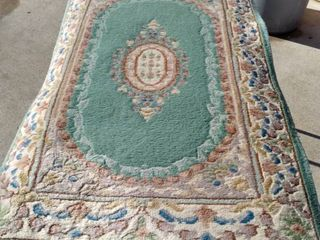 51 x 31 Chinese rug needs cleaned