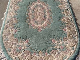 54 x 40 oval Chinese rug needs cleaned