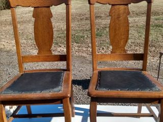 2 vintage oak chairs with leather seats