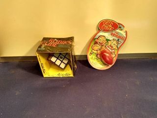 new in package Rubik s cube and the original silly putty