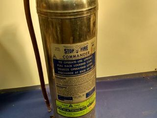 vintage model rjs 50 stop fire Commander fire extinguisher still in the charged position