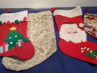 four Christmas stockings one small one