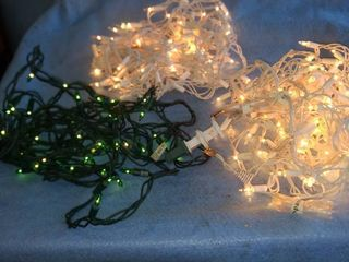 three sets Christmas lights one green two white