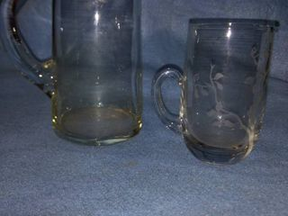 pretty etched glass pitcher with drip edge plus clear pitcher with drip lip no cracks