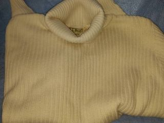 three nice lady sweaters one brand new two good shape one ll Bean White turtleneck size large others size large as well