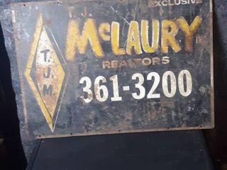 T  J  Mclaury Realtors Sign