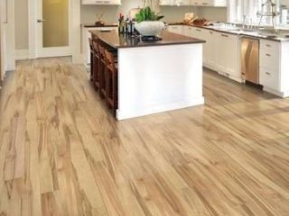 Quickstep studio   spill repel concord maple 6 14 in W x 47 24 in l smooth wood plank laminate flooring