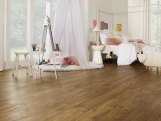 Pergo timbercraft   wetprotect waterproof rustic amber chestnut 7 48 in W x 54 33 in l embossed wood plank laminate flooring