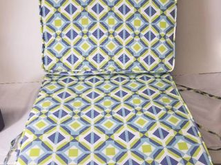 Two Colorful Patio Furniture Cushions  Attached In the Middle