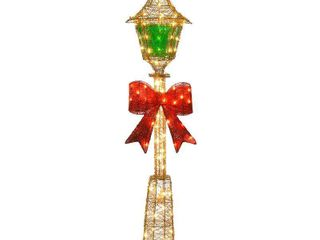 National Tree 60  Gold Wire lamp Post with Green PVC Film and Red Bow and 85 Clear Indoor Outdoor lights