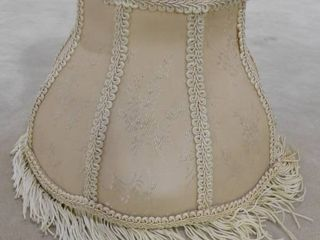 Cream colored small lampshade with hanging tassels